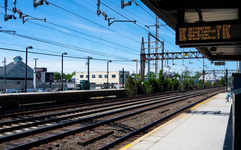 Sunny day image of train station platform